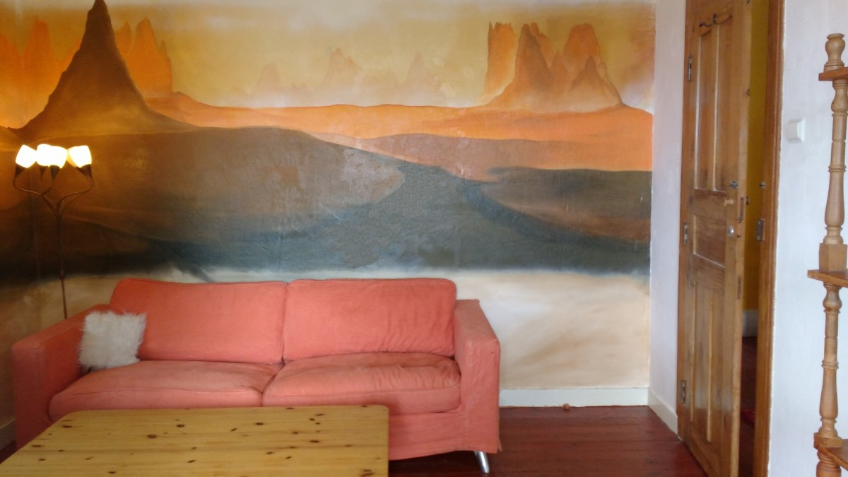 a-mural-of-a-deserted-landscape-in-a-holidayhouse