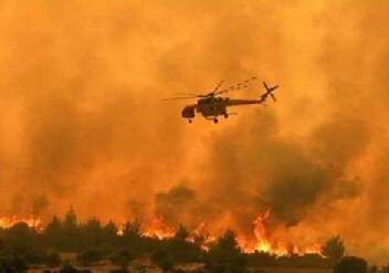 a-helicopter-above-a-fire