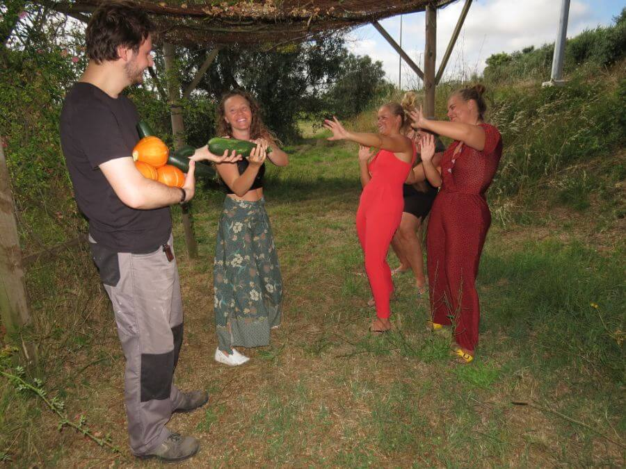 Broes offers zucchini and pumpkin to the girls