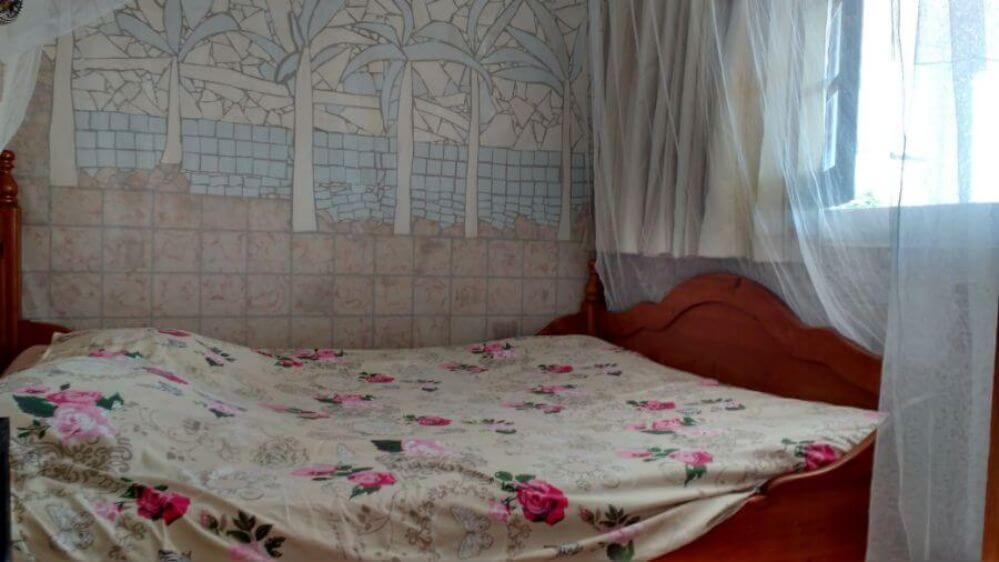 Casa-de-férias-Palmeira-quarto-com-cama-de-casal