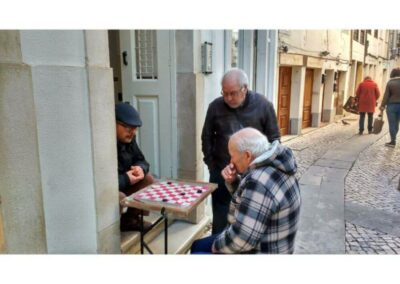men-playing-checkers-in-a-little-street-in-Coimbra-1