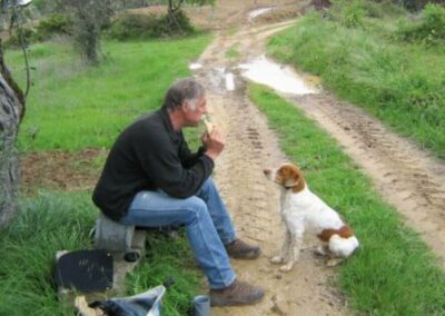 a-man-and-a-dog-having-lunch-during-their-hike-3
